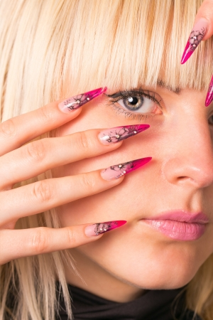 Young beautiful blonde with a nice manicure photo