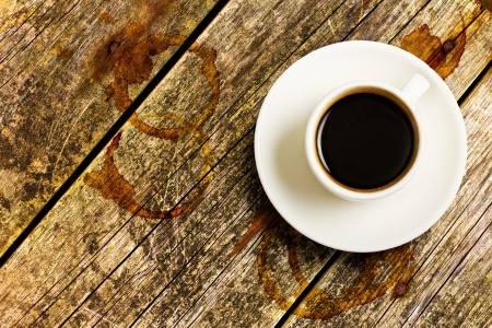 coffee crop: Cup of Coffee on a wood table, top view