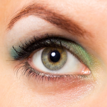 Close-up of a beautiful young womans green eye photo