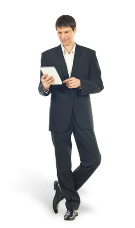 Young businessman using a Tablet computer over white background photo
