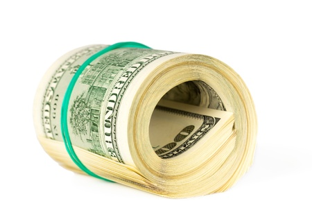 US dollars rolled up and tightened with band isolated on white background photo