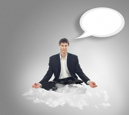 Businessman sitting in lotus position on a cloud Stock Photo - 16523437