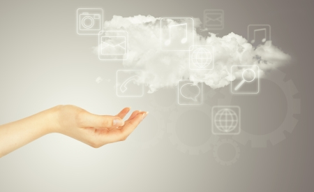 Hand, cloud and multimedia icons. Cloud computing concept - world wide data sharing and communication photo