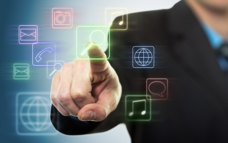 Businessman pressing application button on computer with touch screen Stock Photo - 17342173
