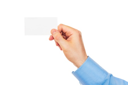 Business card in hand on white background photo