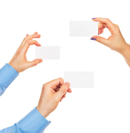 Business cards in hands on white background Stock Photo