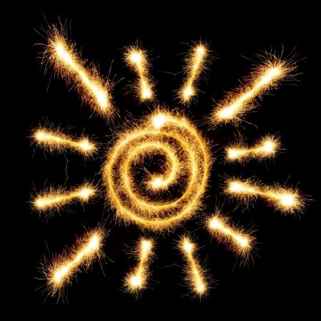 Sun sparkler on black background