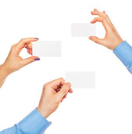 Business cards in hands on white background Stock fotó