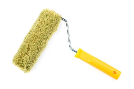 Yellow paint roller with shadow isolated on white background photo