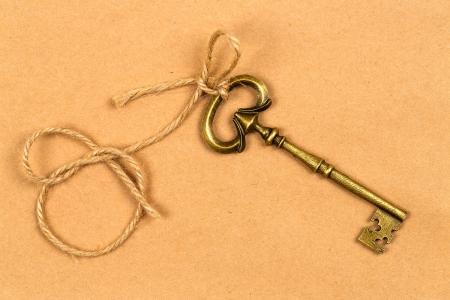 skeleton key: Vintage key with a string