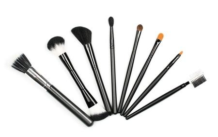 basic care: Professional makeup brush set on white background