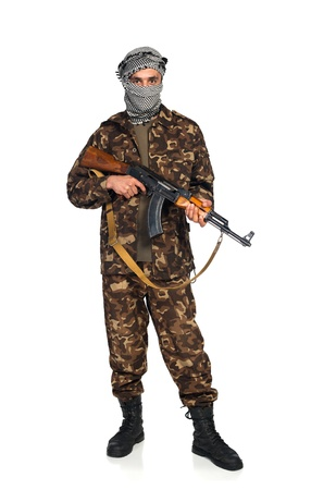 Terrorist Arab nationality in camouflage suit and keffiyeh with automatic gun on white background with reflection Stock Photo - 19098827