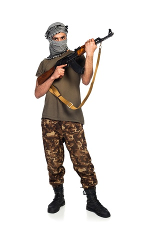 Terrorist Arab nationality in camouflage suit and keffiyeh with automatic gun on white background with reflection Stock Photo - 19098826