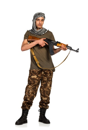 Terrorist Arab nationality in camouflage suit and keffiyeh with automatic gun on white background with reflection Stock Photo - 19098825