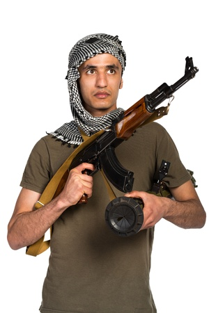 Terrorist Arab nationality in camouflage suit and keffiyeh with automatic gun and launcher on white background Stock Photo - 19098841