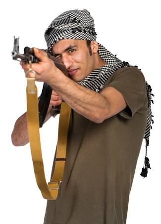 Terrorist Arab nationality in camouflage suit and keffiyeh with automatic gun on white background with reflection Stock Photo - 19098843