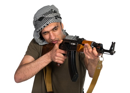 Terrorist Arab nationality in camouflage suit and keffiyeh with automatic gun on white background with reflection Stock Photo - 19098834