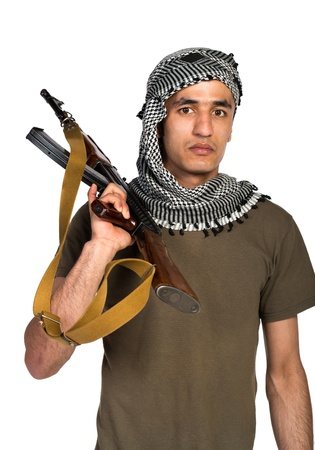 keffiyeh: Terrorist Arab nationality in camouflage suit and keffiyeh with automatic gun on white background