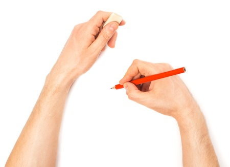 Human hands with pencil and erase rubber writting something. On white background photo