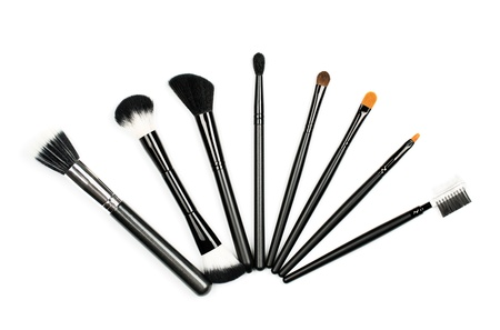 Professional makeup brush set on white background photo