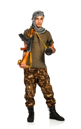 keffiyeh: Terrorist Arab nationality in camouflage suit and keffiyeh with automatic gun and launcher on white background with reflection Stock Photo