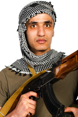 keffiyeh: Terrorist Arab nationality in camouflage suit and keffiyeh with automatic gun and launcher on white background