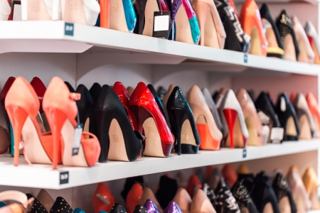 high heeled shoes: Background with shoes on shelves of shop