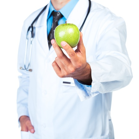 Doctors hand holding a fresh green apple close-up on white background photo