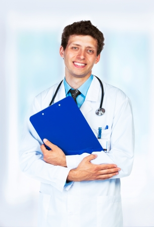 Portrait of the smiling doctor on interior background photo
