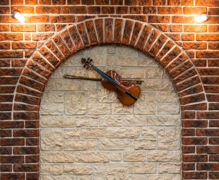 Element of the interior stone arch with a violin on a wall Stock Photo - 20162929
