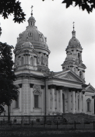 sumy: Trinity Cathedral. Cathedral of the Holy Trinity - the orthodox church in Sumy, Ukraine. An architectural monument of the early XX century neoclassicism. Film photography Stock Photo