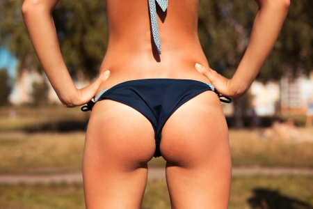 thongs: Beautiful young woman back with bikini Stock Photo