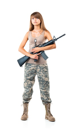 Soldier young beautyful girl dressed in a camouflage with a gun in his hand on white background photo