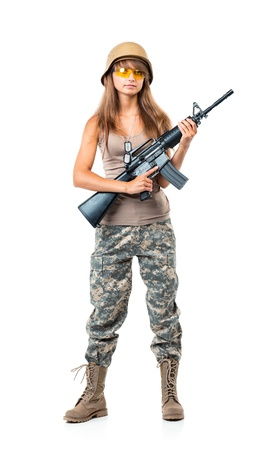 camouflage woman: Soldier young beautyful girl dressed in a camouflage with a gun in his hand on white background Stock Photo