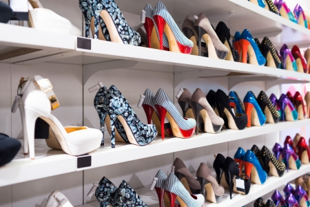 high heel shoes: Background with shoes on shelves of shop