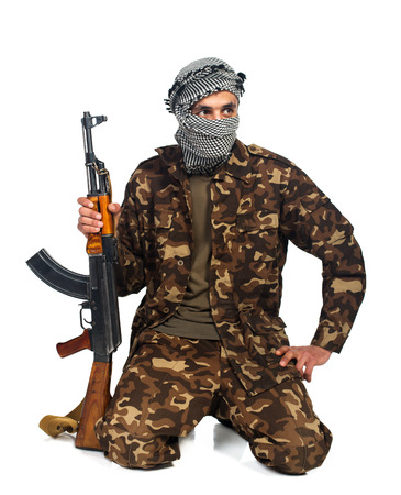 keffiyeh: Arab nationality in camouflage suit and keffiyeh with automatic gun on white background with reflection