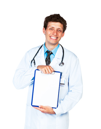 Young male smiling doctor showing clipboard with copy space for text on white background photo