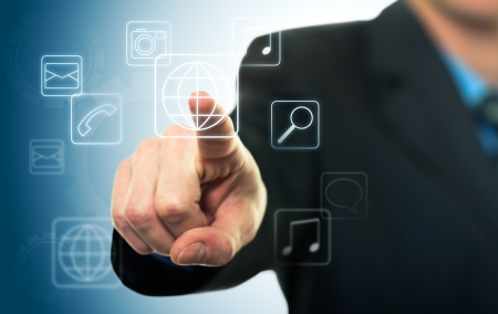 Businessman pressing application button on computer with touch screen photo