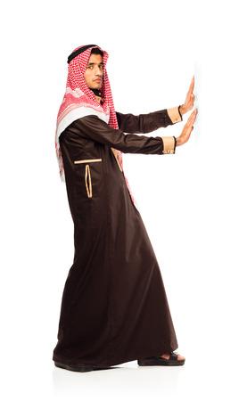 Arab businessman pushing isolated on the white background photo