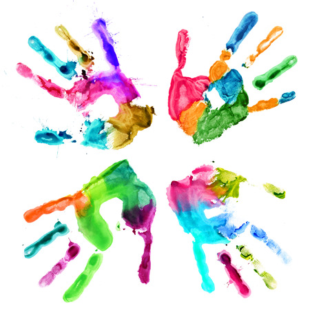 Handprints in different colors on a white background photo