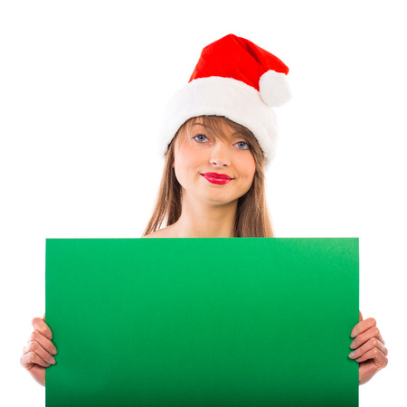 Smiling christmas girl with green placard on white background Stock Photo - 23960317