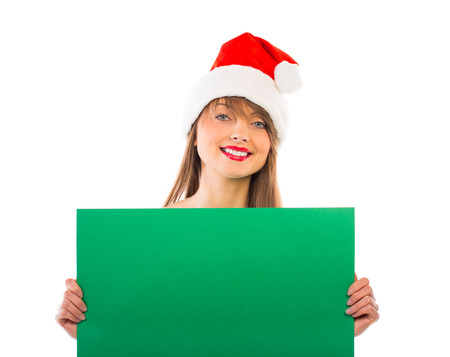 Smiling christmas girl with green placard on white background Stock Photo - 24145102