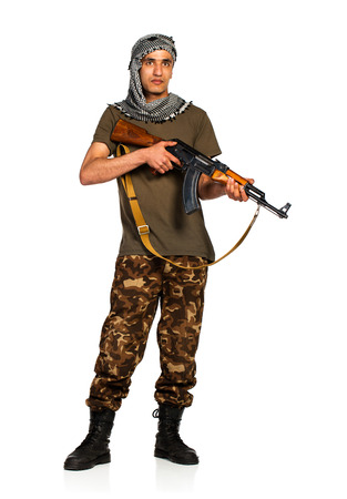keffiyeh: Arab nationality in camouflage suit and keffiyeh with automatic gun on white with reflection Stock Photo