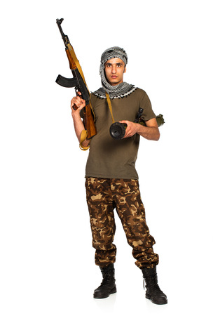 keffiyeh: Arab nationality in camouflage suit and keffiyeh with automatic gun and launcher on white with reflection