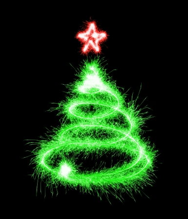 Christmas tree made by sparkler on a black  photo