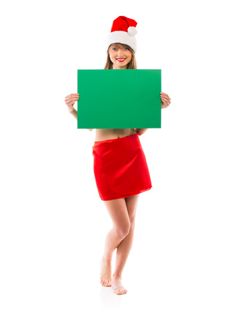 Smiling christmas girl with green placard on white  photo