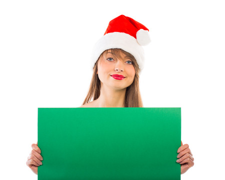 Smiling christmas girl with green placard on white Stock Photo - 24301879