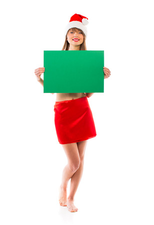 Smiling christmas girl with green placard on white background photo