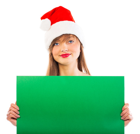 Smiling christmas girl with green placard on white background Stock Photo - 24538303