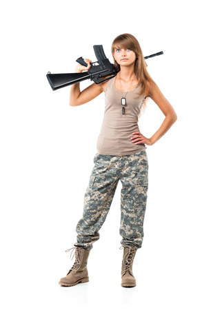 Soldier young beautiful girl dressed in a camouflage with a gun in his hand on white  Stock Photo
